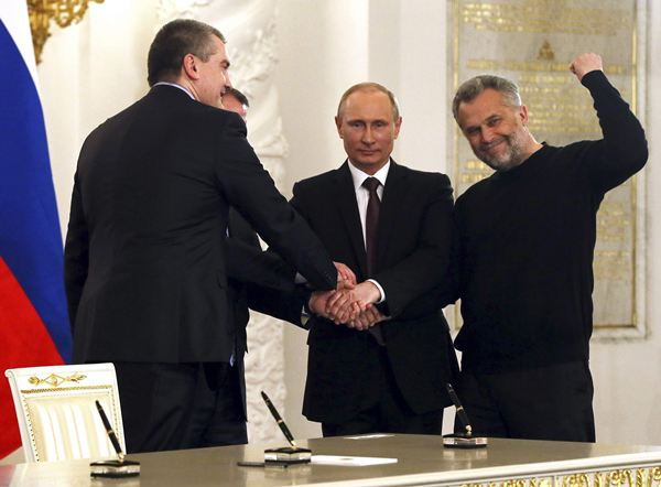Russian President Putin, Crimea's PM Aksyonov, Crimean parliamentary speaker Konstantinov and Sevastopol Mayor Chaliy shake hands after a signing ceremony in Moscow