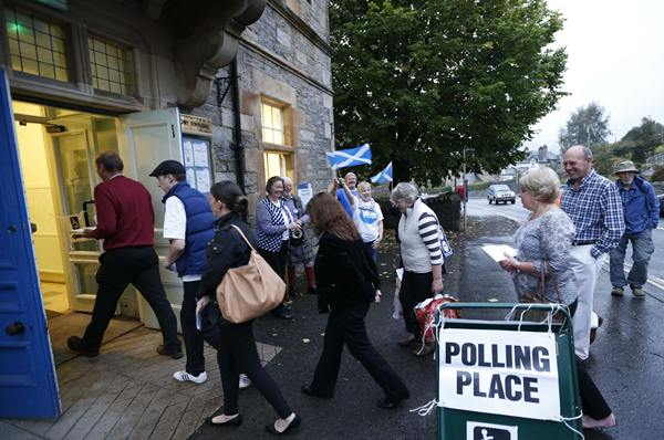 Voters enter a polling station to place their votes during the referendum on Scottish independence in Pitlochry