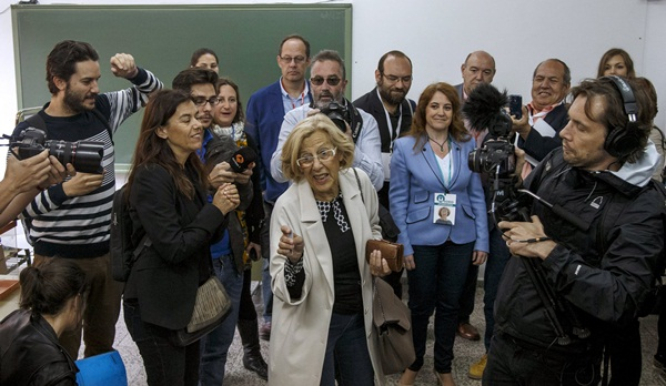Carmena, local candidate of Ahora Madrid (Now Madrid), gestures after casting her vote at a polling station during regional and municipal elections in Madrid