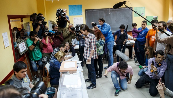 Podemos (We Can) leader Iglesias votes at a polling station during regional and municipal elections in Madrid