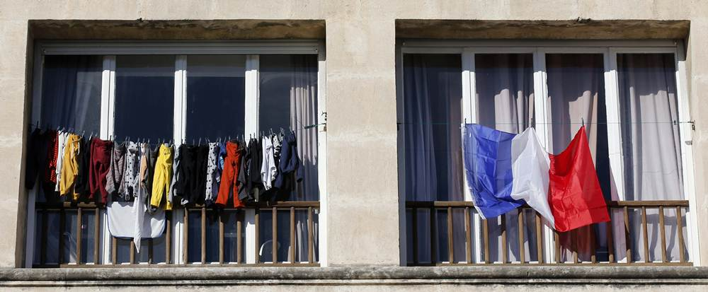 A French national flag hangs from a balcony in Marseille to pay tribute to the victims of the Paris attacks