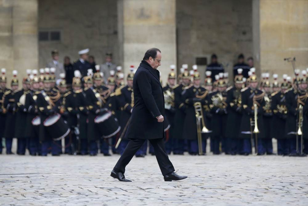 French President Francois Hollande attends a ceremony to pay a national homage to the victims of the Paris attacks at Les Invalides monument in Paris