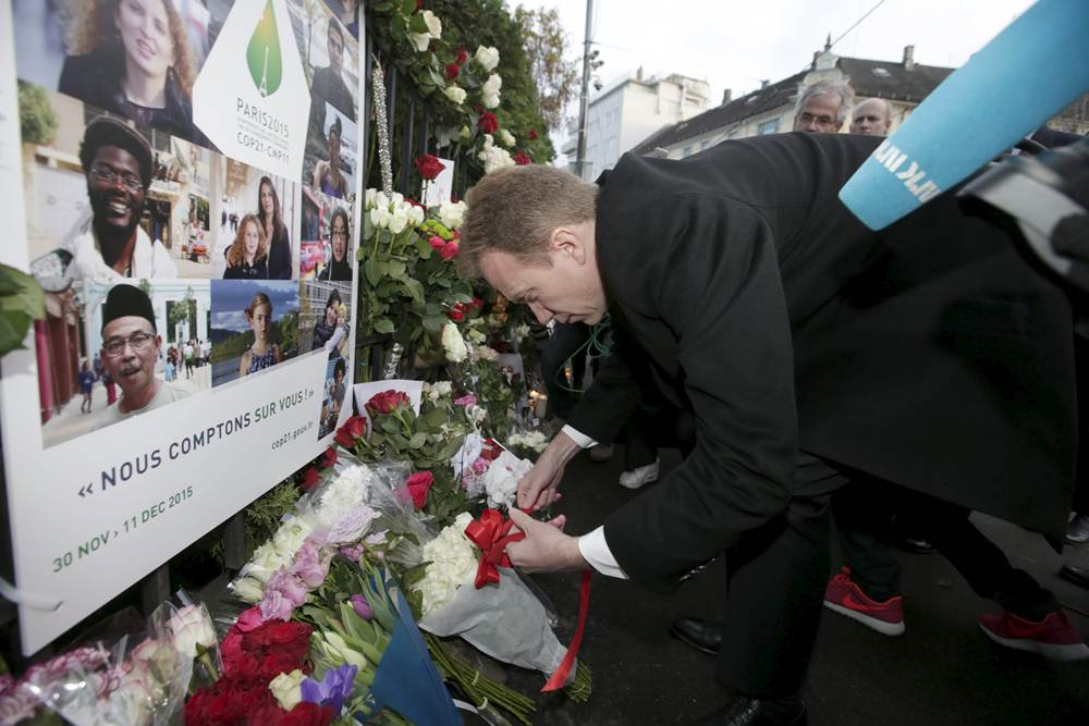 Norway's Foreign Minister Borge Brende places flowers in front of the French embassy in Oslo