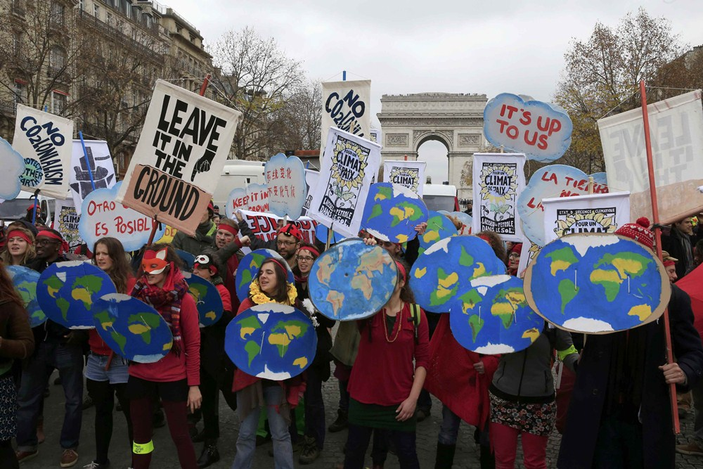Environmentalists demonstrate in Paris as the World Climate Change Conference 2015 (COP21) continues at Le Bourget