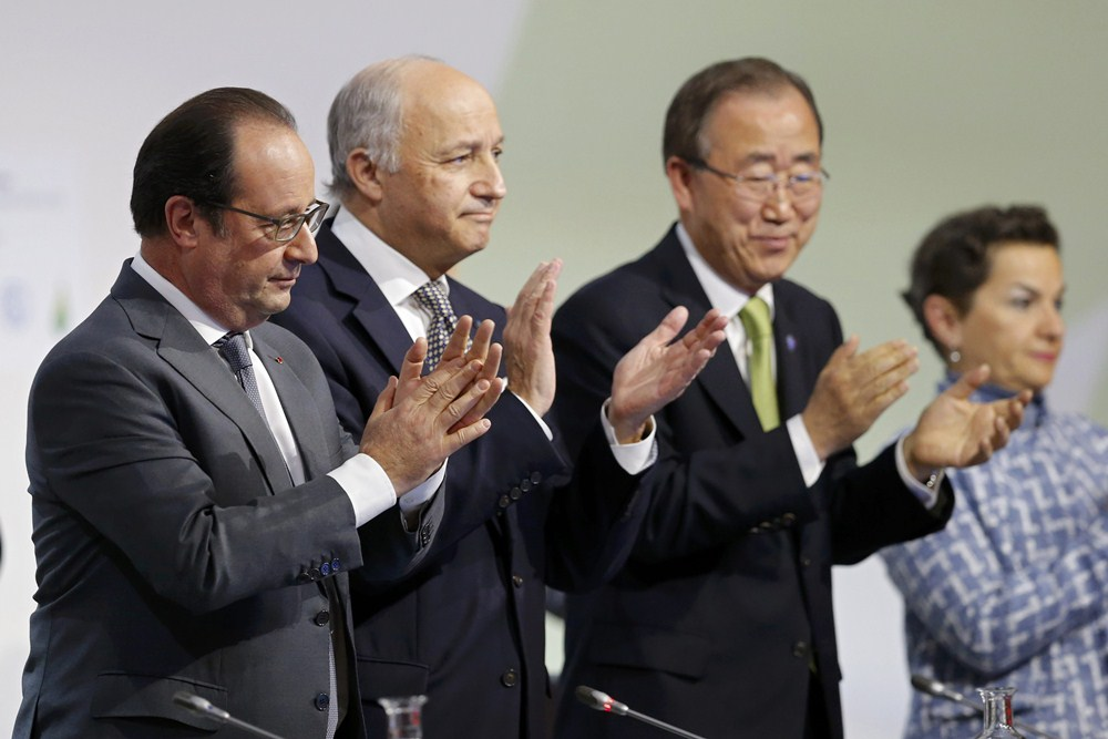 French President Francois Hollande, Foreign Affairs Minister Laurent Fabius, President-designate of COP21, United Nations Secretary-General Ban Ki-moon and Christiana Figueres applaud at the World Climate Change Conference 2015 (COP21) at Le Bourget