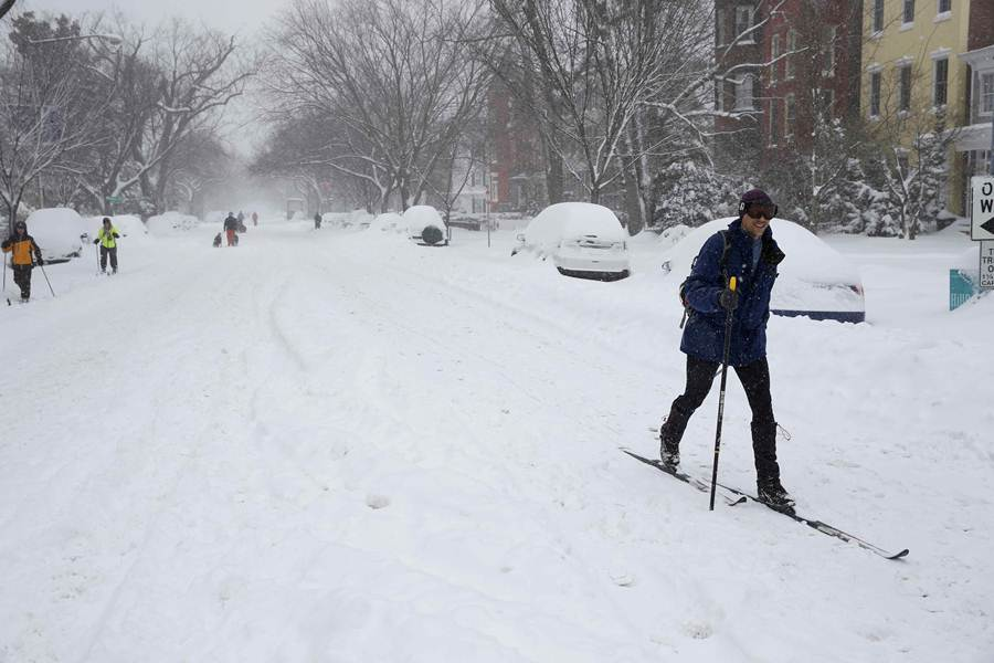 A person skis down a snow-covered street in Washington