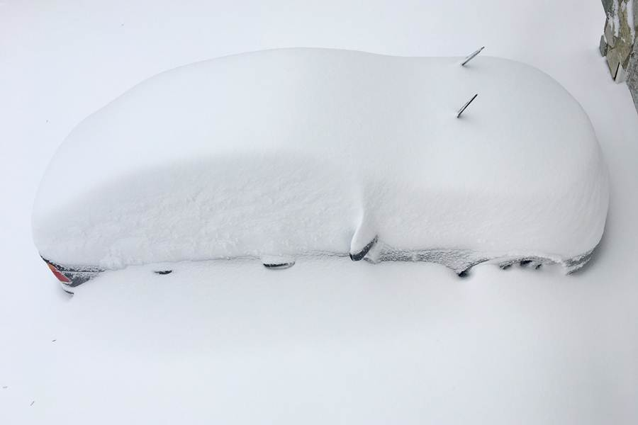 A car is buried in snow from an overnight snowstorm inside Washington DC Beltway in Annandale, Virginia