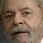 Brazil's former President Luiz Inacio Lula da Silva reacts during a meeting in Rio de Janeiro, Brazil, in this December 3, 2015 file photo. Federal police went to the home of Lula on March 4, 2016 after a warrant was issued to bring him in for questioning in the latest round of the Operation Carwash anti-graft investigation, local media said.  REUTERS/Ricardo Moraes/Files